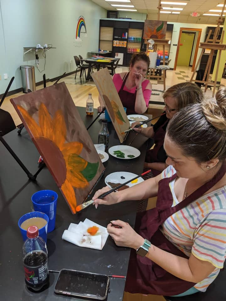 Guests painting Half Sunflowers