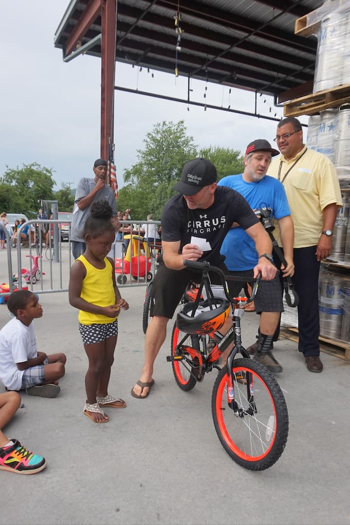 Giving bikes to kids who need them- RAD!