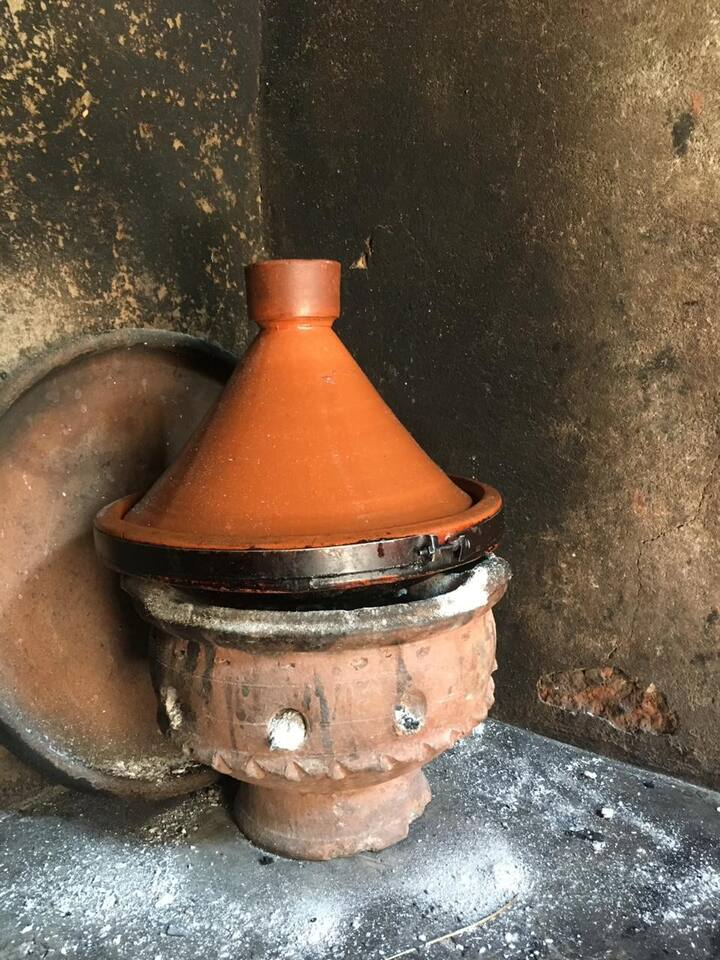 Traditional Tajine on wood fire.