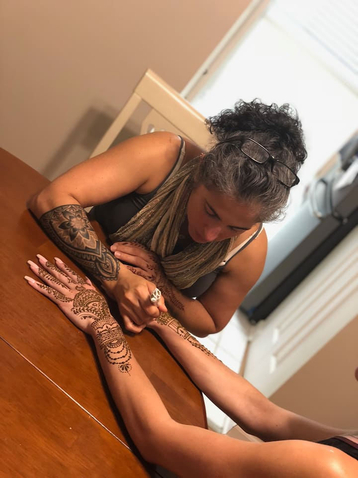 Doing henna for a guest