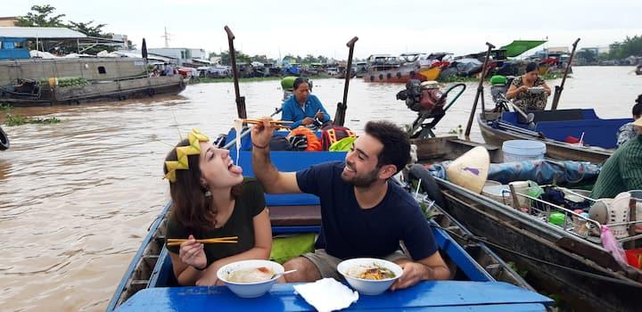 Having a noodle soup at floating market