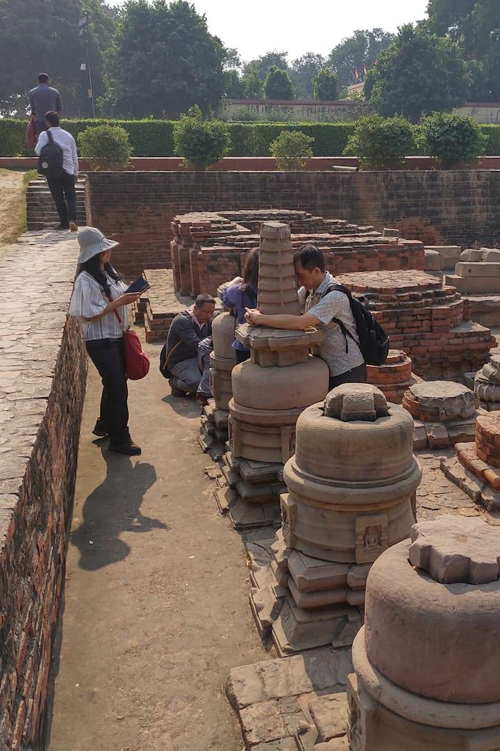 Buddhist pilgrims praying at the excavat