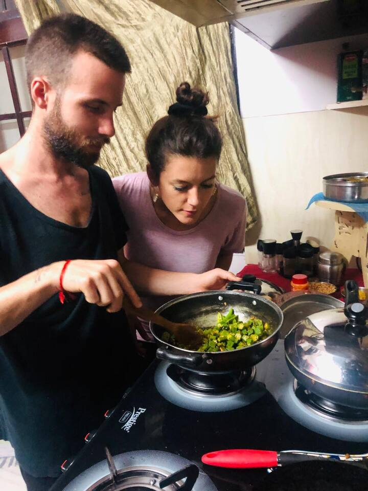 Guests cooking okra curry
