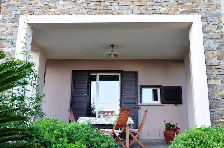 Apartment with a sea view garden and veranda