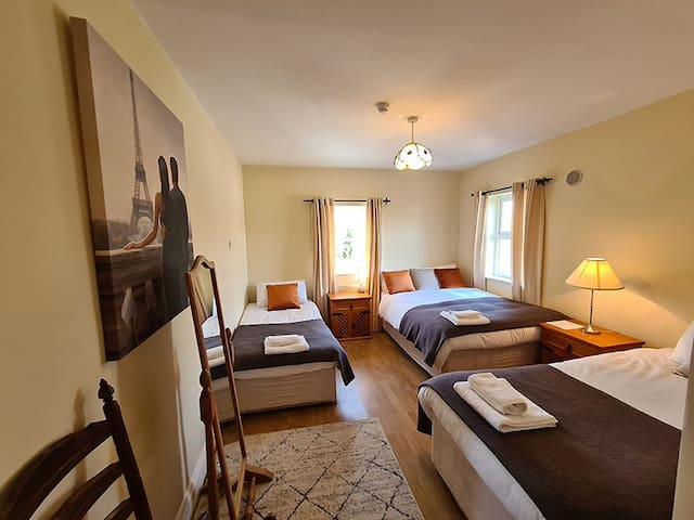 Room 1 interior,  1 queen bed 2 single beds with ensuite.
