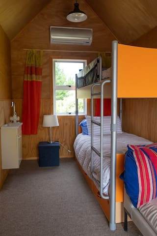 Inside the sleep out - bunk bed sleeps two people, and there is a pull out bed below for a third person