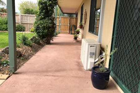 Wide, flat pathway from side entry gate to sliding door entry.