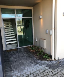 There is a light at the front entrance, however it is turned on from inside the townhouse.