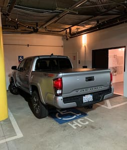 Disabled parking sport (permit required) right next to the lobby door and elevator