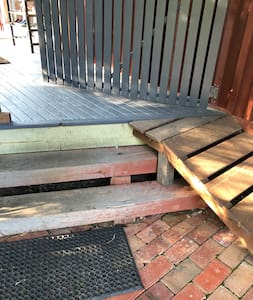 There are two steps up to the front door, but a wheelchair can be pulled up on the side ramp