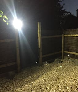 Security light from parking to low lighting along path to the house