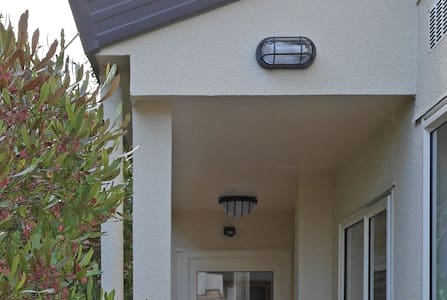 There are three lights that are motion sensor activated, one on the front of the house, and these two at the entrance to the apartment.