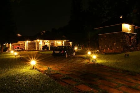 The well-lit frontage of our property, The Shelter
