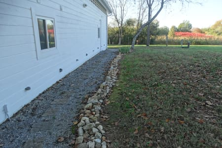Gravel and stepping-stone path lit by solar lighting.