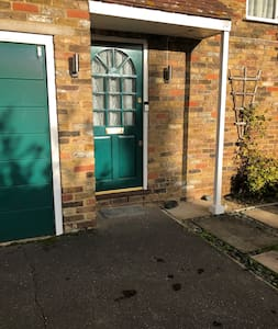 There are security lights either side of the doorway which come on when someone comes up to the front door.    There is a smallish step up from the driveway to the front door.