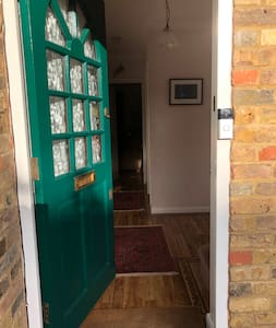 This doorway is just over 32 inches wide but there is an 8 inch step which makes it not wheelchair friendly.  Also my room is on the first floor with no lift.