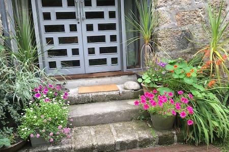 The steps to the door and wide door