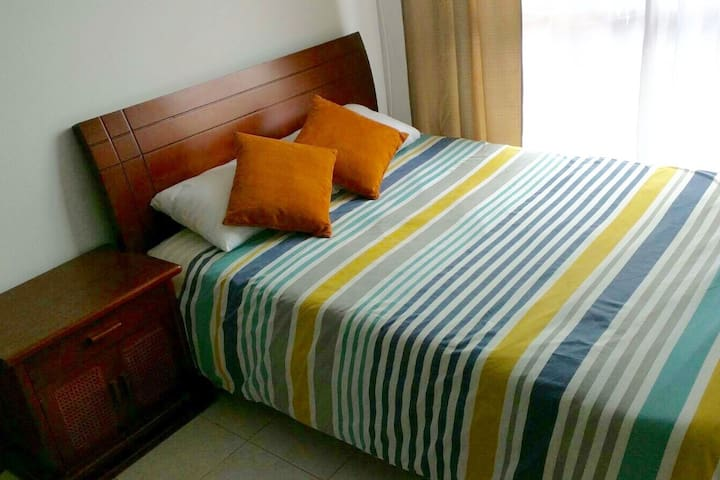 Bedroom features a queen bed, fits to people comfortably.
