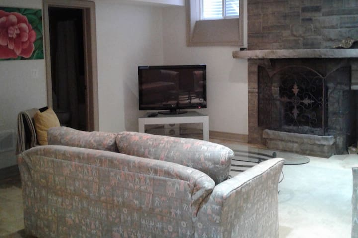 Living area with wood burning fireplace and heated floors