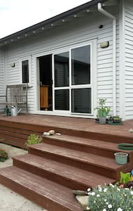 Stairs up to the deck make wheelchair access difficult. Excellent security lights make night time arrival easy
