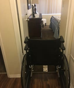 """Wheelchair going from hallway to 1st bedroom. Hallway is 36"""" wide."""