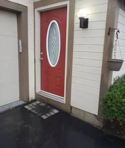 open area suburban home with light near entrance.