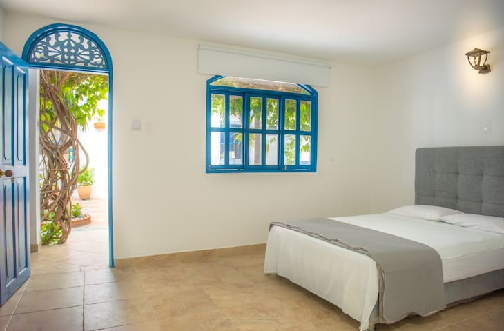 Single Suite/ Private Restroom/ Quiet Air Conditioner/ Fan/Blackout blinds/ Flat TV/ Garden View