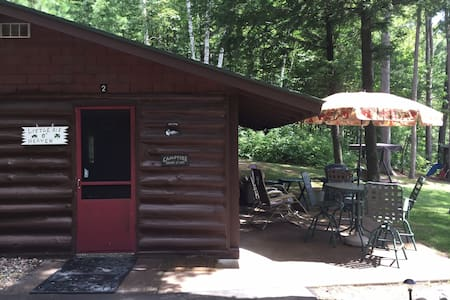 This is the entrance to the cabin. There is a small threshold to cross over when entering the door, but no steps.   There is a gentle slope, paved drive from the hill down to the cabin and a gentle slope to the beach, dock and water with no steps.