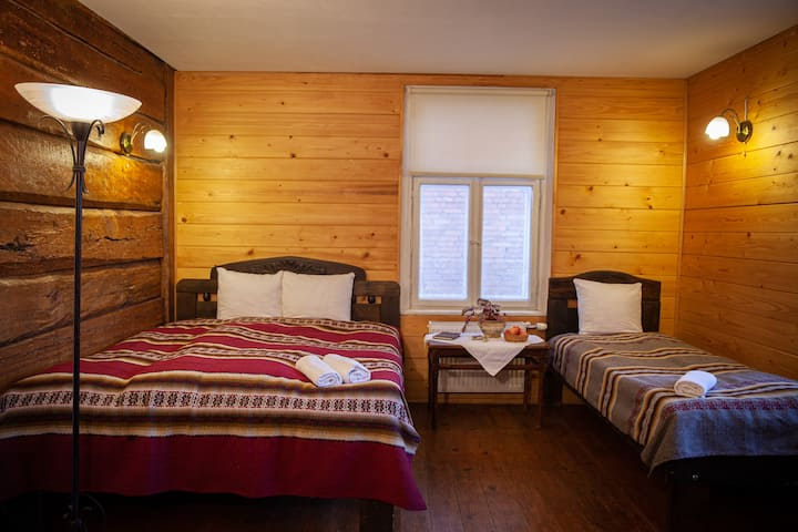 Room with double bed and single bed