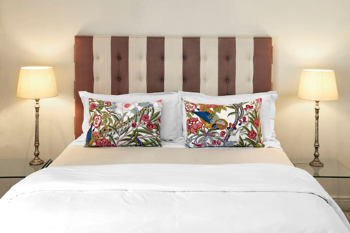 A spacious bedroom with gorgeous views to wake up to. All of our suites are designed differently to bring a lot of colour in & show a large variety of our local designs!