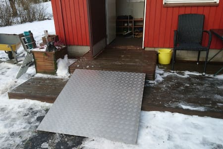 Ramp for wheelchair and outdoor lights.