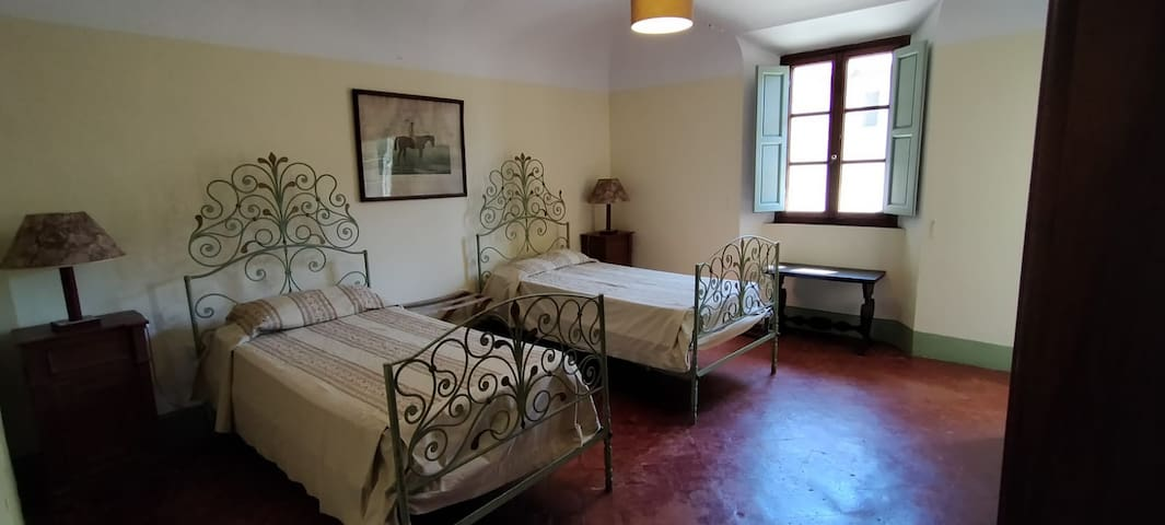 Arlecchino, large twin room with small reading area.  Shares a bathroom and kitchenette with Bull