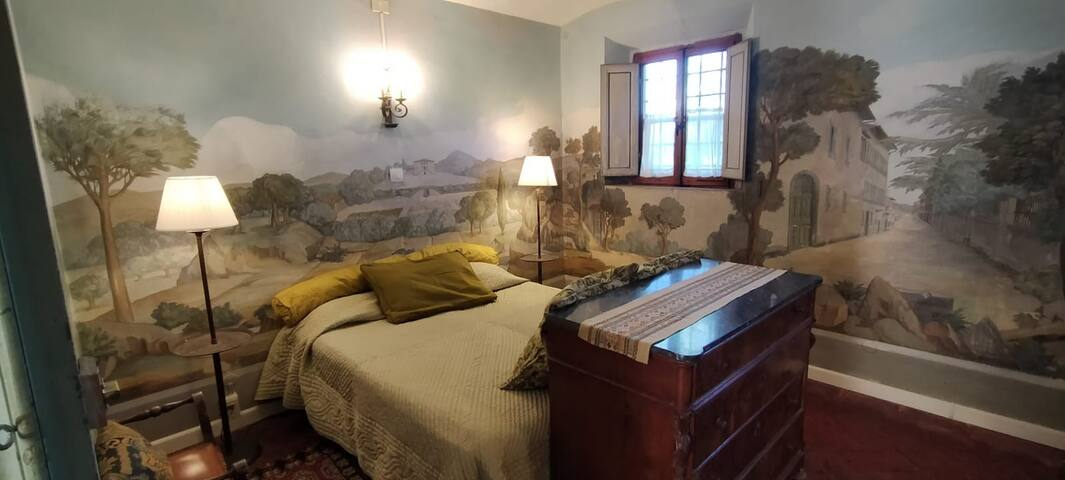 Prince bedroom, with beautiful landscape painted walls (part of ground floor apartment), with ensuite bathroom and desk