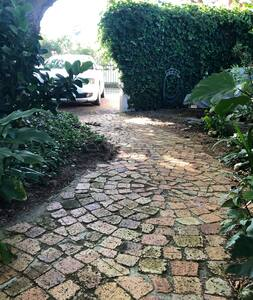 Wide flat brick pathway from Guest suite to driveway. Path is 110-120cm wide