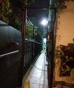 separate entrance on the side of the house that guides you to your room. it is well illuminated.. the area is very safe, still there are surveillance cameras around the house.
