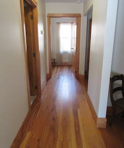 The hallway is 42 inches wide. All the doors are handmade and  35 inches wide.