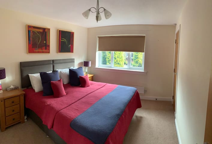 Main bedroom with super king bed and wardrobe.