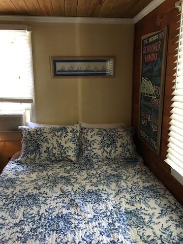 Bedroom 2, the Schooner Hindu bedroom, has a queen bed, room AC, sea chest, and a closet.