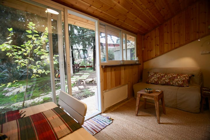 A nice wooden living room with large sliding doors and a window