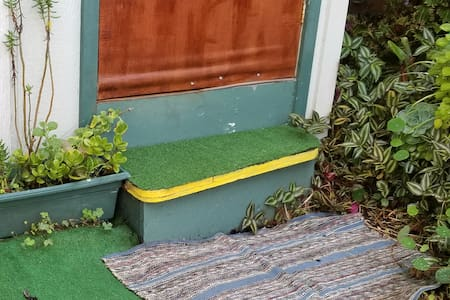 A step up to the flush toilet located steps aw333zy from ohana entrance in your garden area.