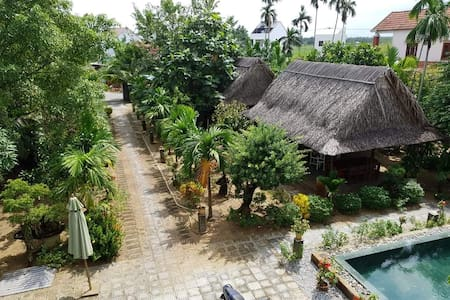 Garden with many tropical trees and fruit trees and tropical flowers