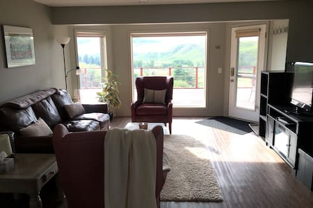 The deck door leads directly into a spacious living, dining, kitchen area with ample space for wheelchair mobility
