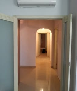 The hallway and entrances to the bathroom and bedrooms