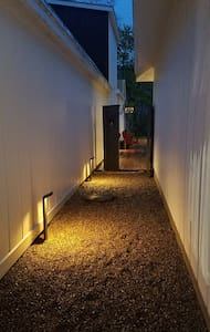 This is the walkway from the sidewalk to the deck where the townhouse entrance is located.