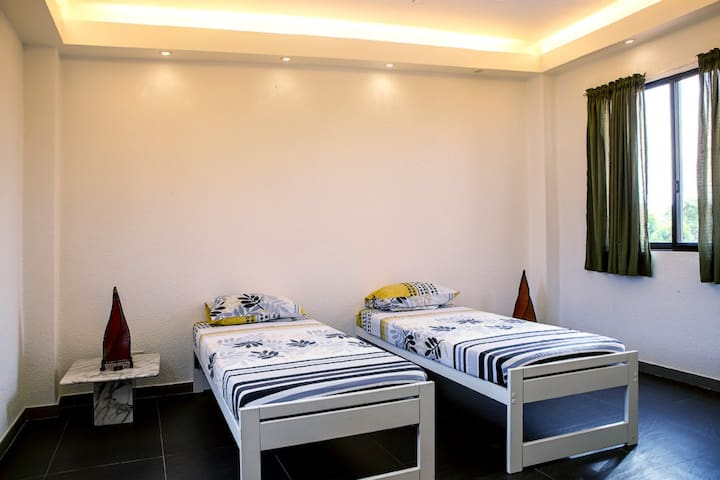 Second bedroom with 2 single beds and direct access to the terrace. Aircon available.