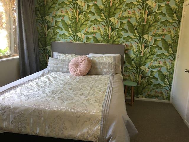 Queen sized bed in separate bedroom
