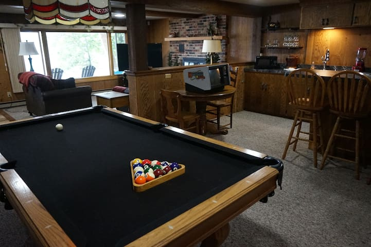 lower level game room that includes walkout to the lake.