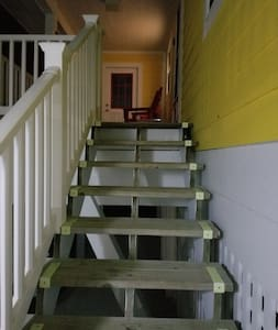 Stairs leading to front door.