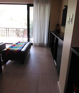 Path from dining to living room and balcony. The bench is very light and easily moveable