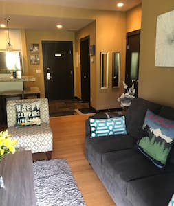 This photo shows main entrance to the condo. The building has 2 elevators and the main entrance has wheelchair access.  Two disabled parking stalls in underground parkade. Huge shower, and we can provide shower chair for our guest upon requested.